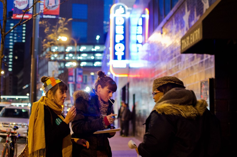 Event worker Artiste Mayfield encourages Leah Caspers and Lindsay Johnson to vote for U.S. Representative Keith Ellison against the voter ID and marriage amendments Sunday night outside of the #GetOutToVoteMN concert at First Avenue. The Ellison campaign hosted the the concert to encourage young people to go to the polls in November.