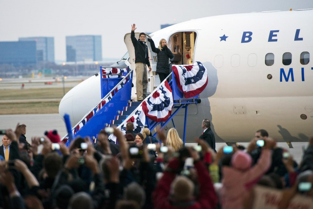 Vice presidential candidate Paul Ryan and his wife Janna Little wave at supporters before their departure after a rally Sunday, Nov. 4, 2012,  at the Sun Country Airlines hanger at the Minneapolis/St. Paul International Airport.