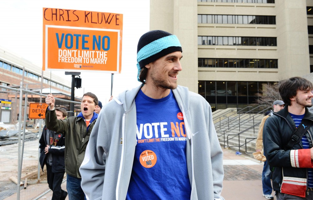 Minnesota Vikings punter Chris Kluwe canvasses campus with MN United workers to encourage students to vote against the Marriage Amendment on Tuesday in Stadium Village.