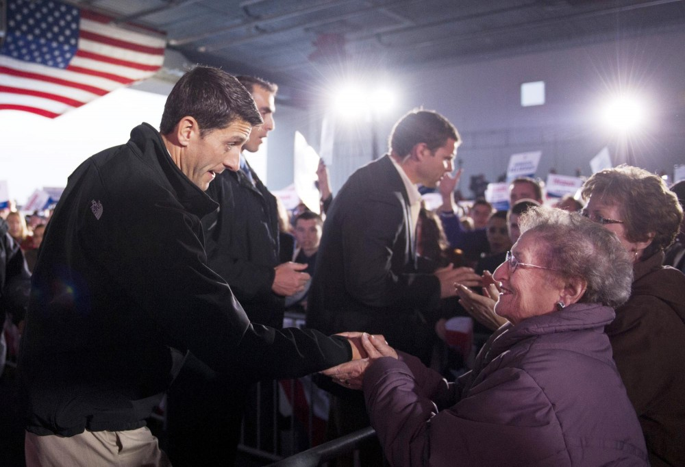 Vice presidential candidate Paul Ryan shakes hand with his supporters after a rally Sunday, Nov. 4, 2012,  at the Sun Country Airlines hanger at the Minneapolis/St. Paul International Airport.