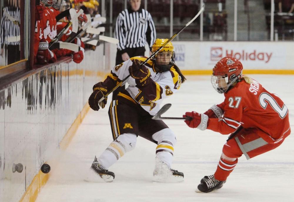Minnesota defender Milica McMillen battles for the puck against Ohio State defender Annie Svedin on Oct. 20 at Ridder Arena.