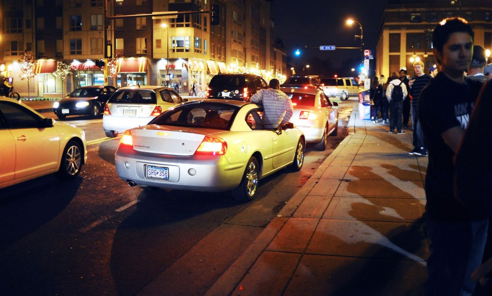 Late-night traffic fills the intersection of Fourth Street Southeast and 15th Avenue Southeast during Homecoming weekend.