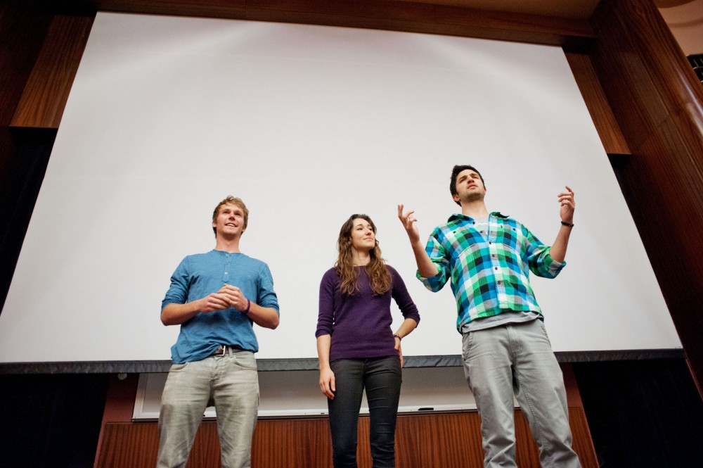 Chris Temple, Hannah Gregg and Zach Ingrasci prepare to present their film, Living on One Dollar, on Sunday night at the Bell Museum of Natural History. Temple and Ingrasci, graduates of Claremont McKenna College in California, produced the film about their experiences of living on less than a dollar a day for two months in Guatemala.