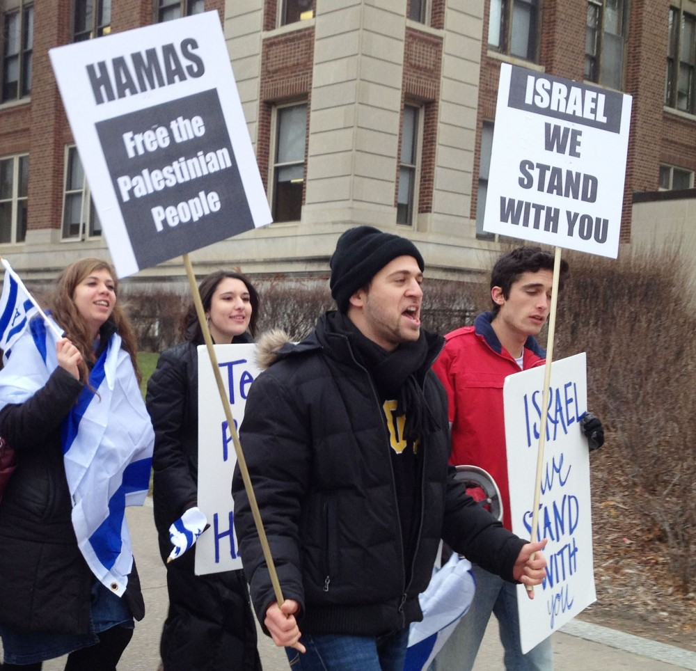 Students Supporting Israel president Ilan Sinelnikov, center, leads a march Tuesday, Nov. 27, 2012, on Northrop Mall.