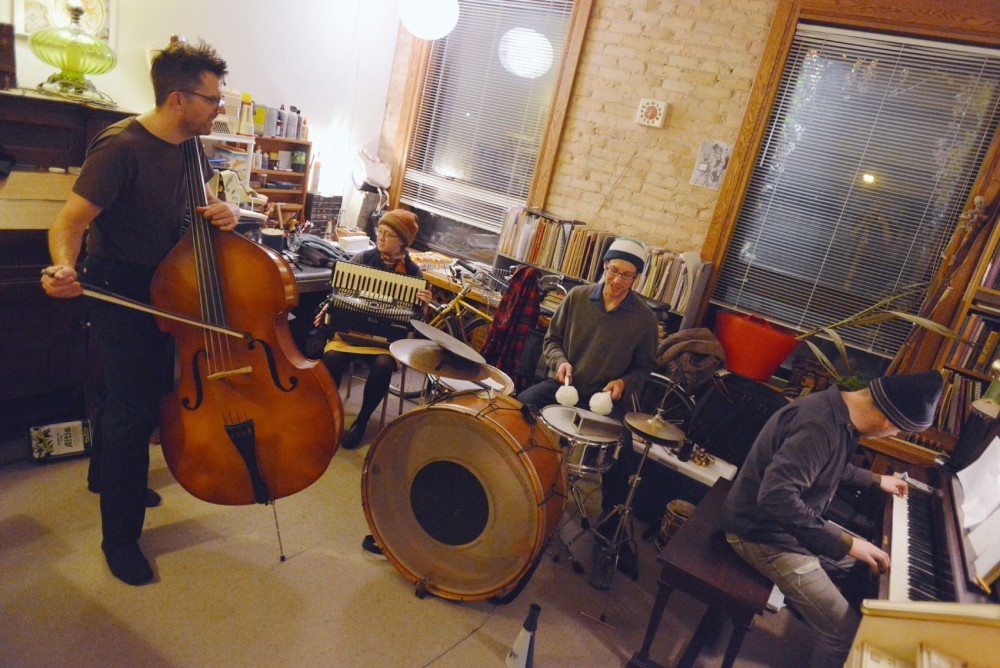Andy McCormick, left, Karen Majewicz, left center, Ryan Billig, center, and Chris Hepola of Dreamland Faces rehearse in their studio space in the Seward neighborhood on Wednesday. The band will be performing at the Hennepin County Library in Minneapolis on Thursday.