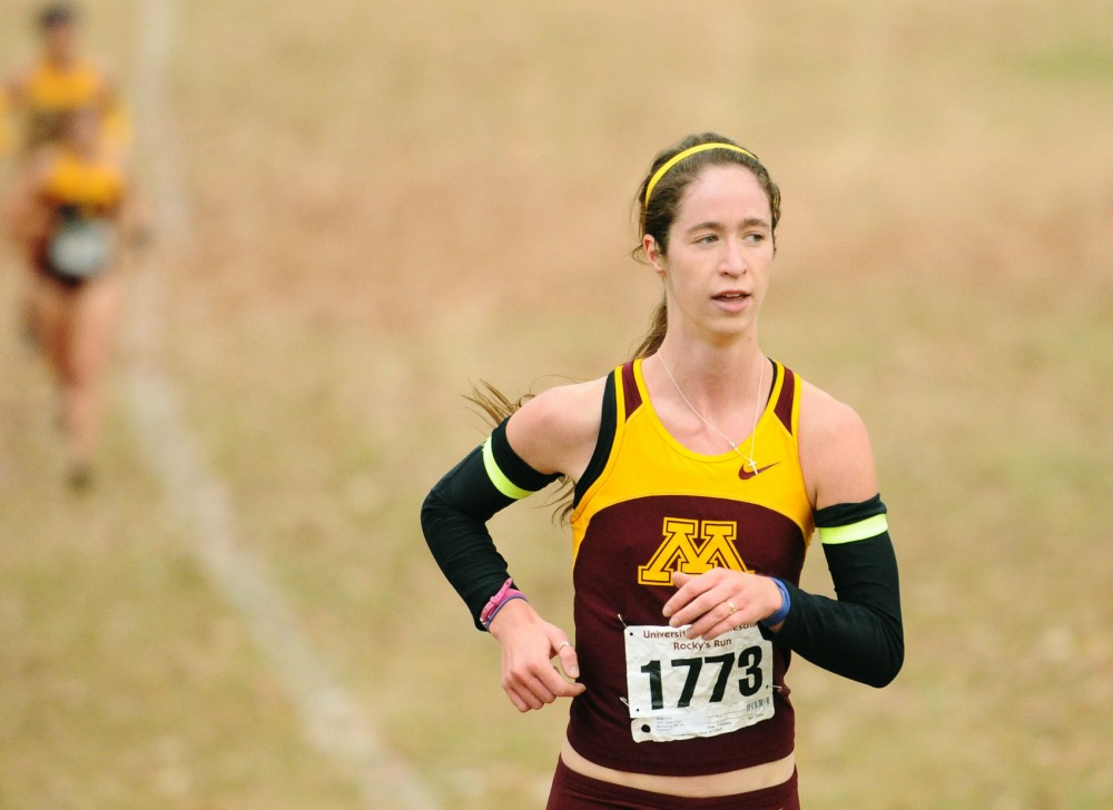 Minnesota runner Cassy Opitz runs in Rocky's Run at Les Bolstad Golf Course on Sunday. Opitz was the top woman's finisher and finished the 6K race in 22:44.