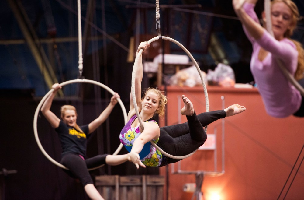 Seventeen-year-old Libby Ulm, center, of White Bear Lake, practices on a hoop Oct. 26 at Circus Juventas in St. Paul. Ulm has been practicing in the circus for 12 years.