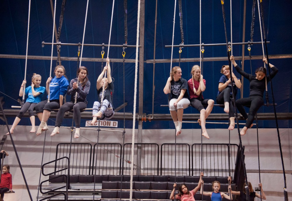 Students sit on trapezes waiting for class to start Friday at Circus Juventas in St. Paul.