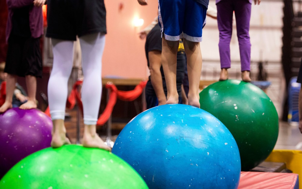 Circus students walk on balls during a balance practice Friday at Circus Juventas in St. Paul.