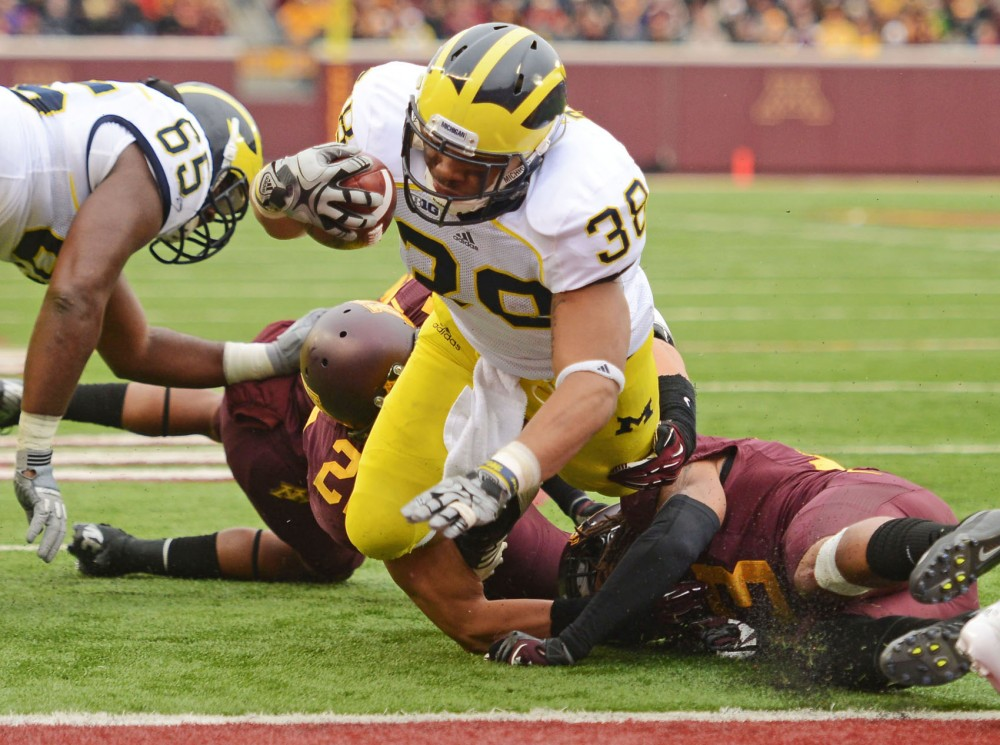 Michigan running back Thomas Rawls scores a touchdown against Minnesota on Saturday at TCF Bank Stadium.