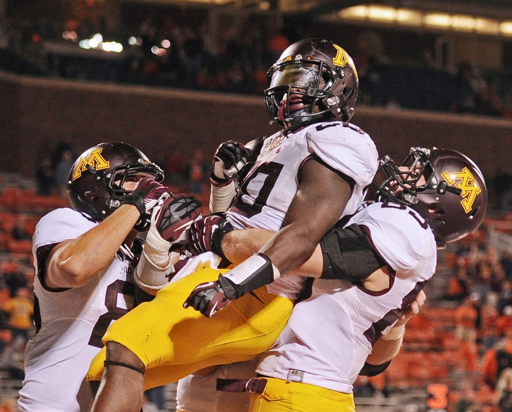 Gophers offense celebrates after Minnesota running back Donnell Kirkwood scores their second touchdown of the game against Illinois on Nov. 10, 2012 at Memorial Stadium in Champaign, Ill.