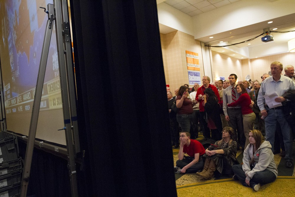 Romney supporters gather in front of a screen airing Fox News to watch as states declared their election results Tuesday at the GOP election night party in Bloomington, Minn.