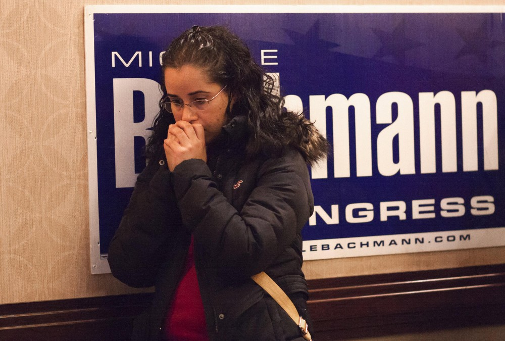 Jorgelina Melendez waits as election results come in on Fox News on Tuesday at the GOP election night party in Bloomington, Minn. Melendez moved from Ohio two months ago and voted republican in Minnesota.