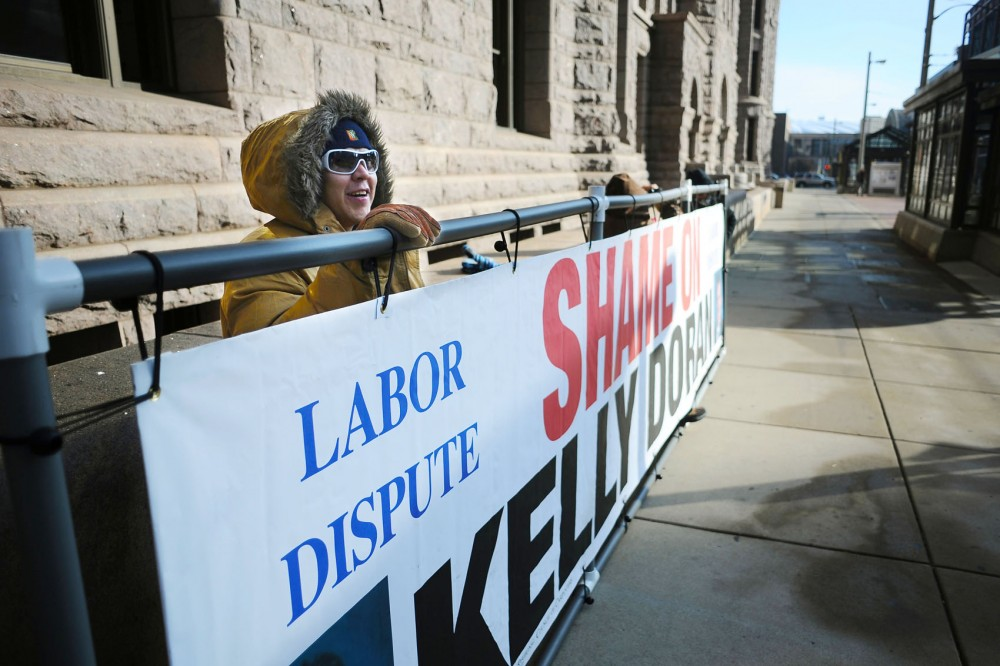 Representatives of the North Central States Regional Council of Carpenters protest the contracting practices of Doran Companies on Wednesday outside Minneapolis City Hall.