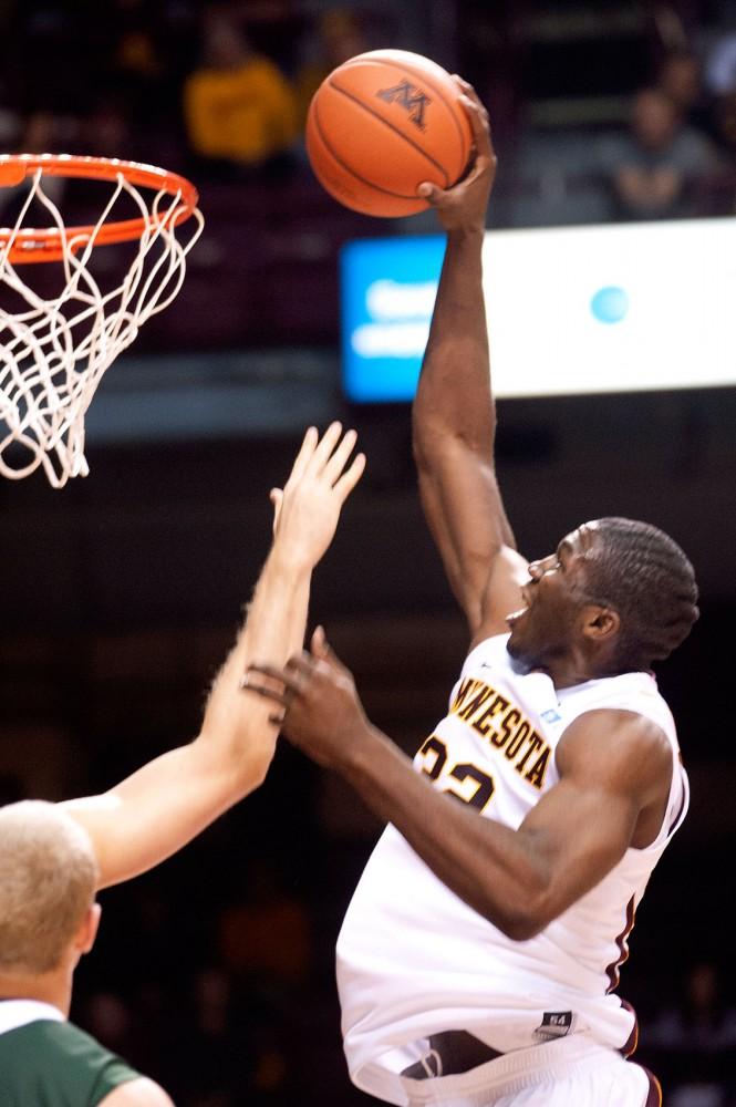 Minnesota forward Trevor Mbakwe rises for a dunk against Bemidji State on Nov. 1, 2011 at Williams Arena.