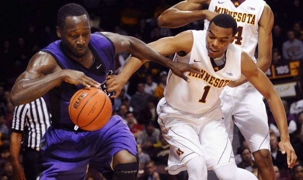 Minnesota guard Andre Hollins tries to gain possession of the ball in the game against Southwest Baptist on Monday at the Williams Arena.