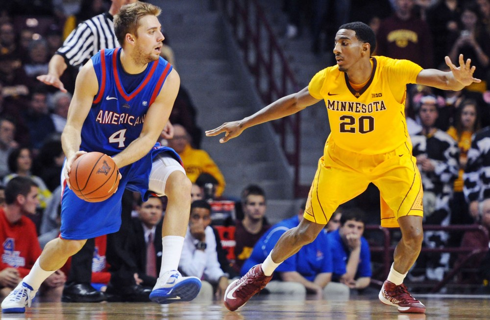 Minnesota guard Austin Hollins attempts to block American guard Austin Carroll on Friday night at the Williams Arena. Hollins scored a career-high 20 points in the game.