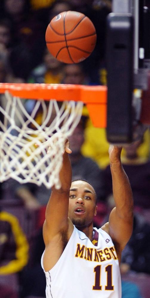 Minnesota guard Joe Coleman makes a jump shot during a game against Toledo Monday at Williams Arena.