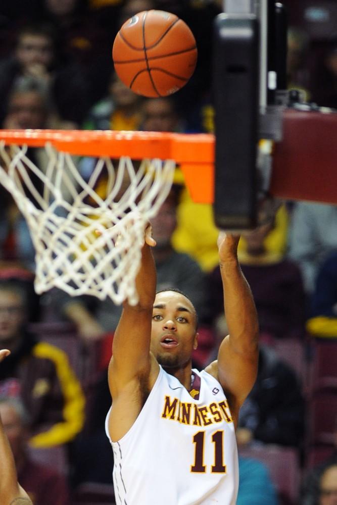 Minnesota guard Joe Coleman shoots a jumper against Toledo on Nov. 12 at Williams Arena.