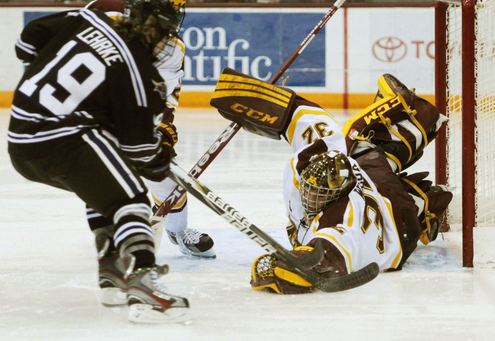 Freshman goaltender Adam Wilcox grabs the puck in the game against Minnesota State on Friday at  Mariucci Arena.