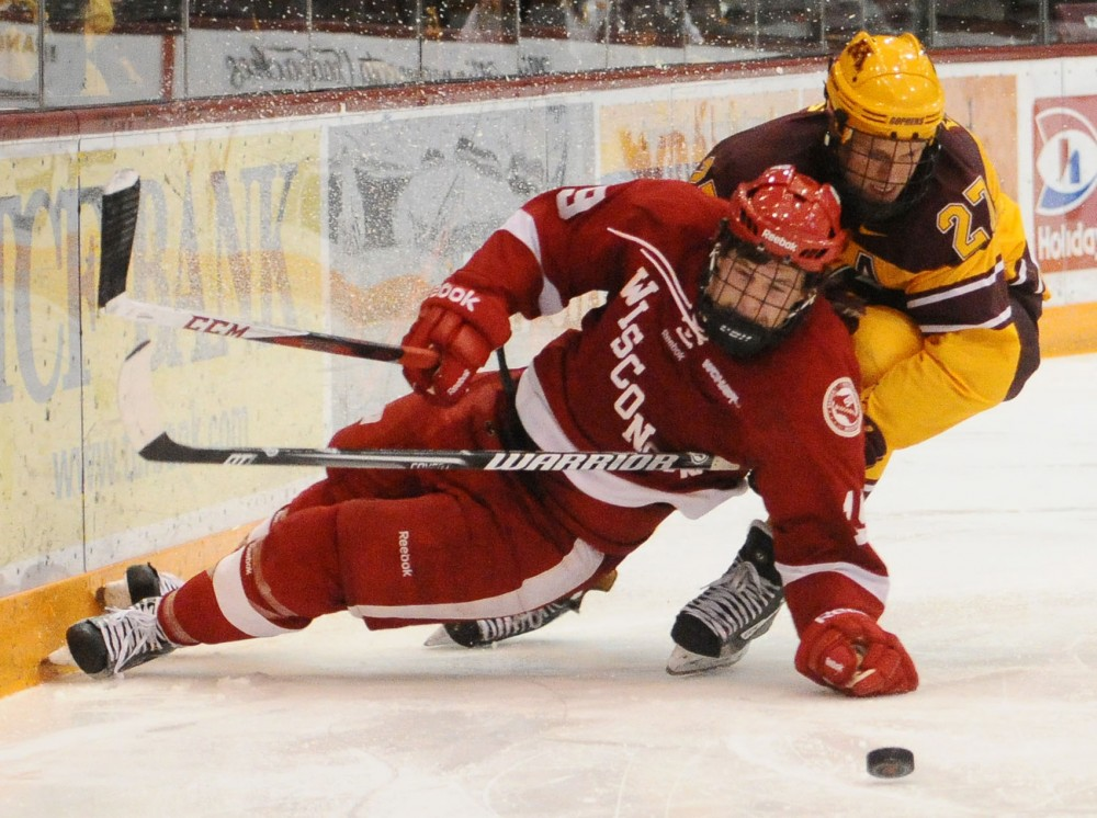 Minnesota forward Nick Bjugstad takes down Wisconsin defender Jake McCabe on Saturday at Mariucci Arena. The Gophers defeated the Badgers 3-1.