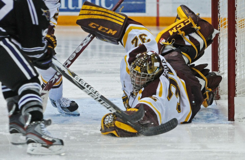 Minnesota goalie Adam Wilcox grabs the puck during a game against Minnesota State on Friday, Nov. 2, 2012, at Mariucci Arena.