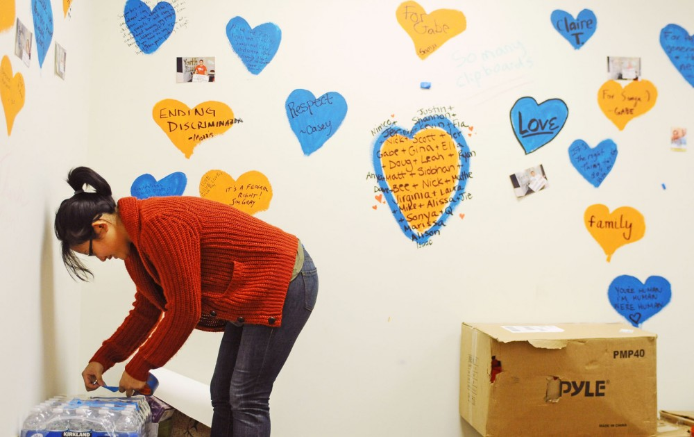Minnesotans United for All Families youth organizer Yer Lor packs up the group's Dinkytown office Saturday afternoon. The group opened the office weeks before Election Day to ramp up campaign efforts against the marriage amendment, which was rejected by voters last Tuesday.