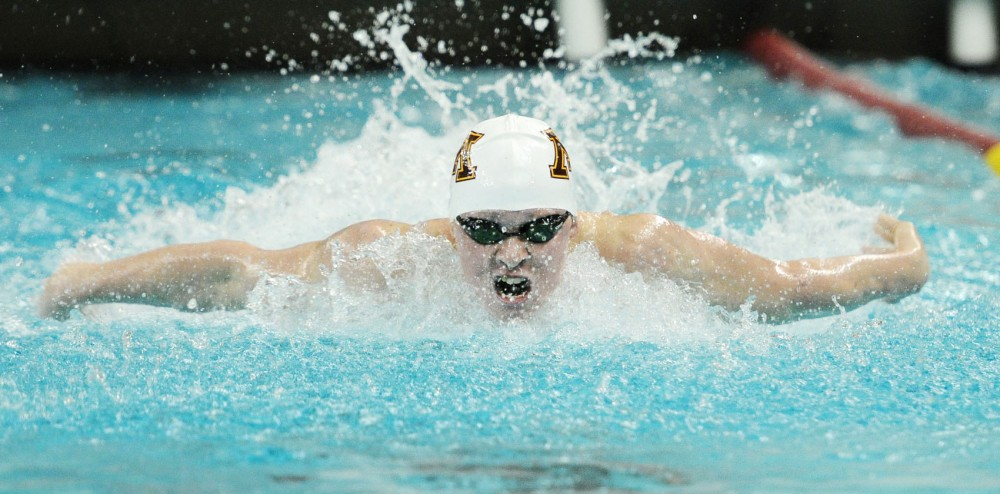Brandon Hatanaka swims during the men's 200-yard butterfly at the University Aquatic Center against Iowa on Friday.