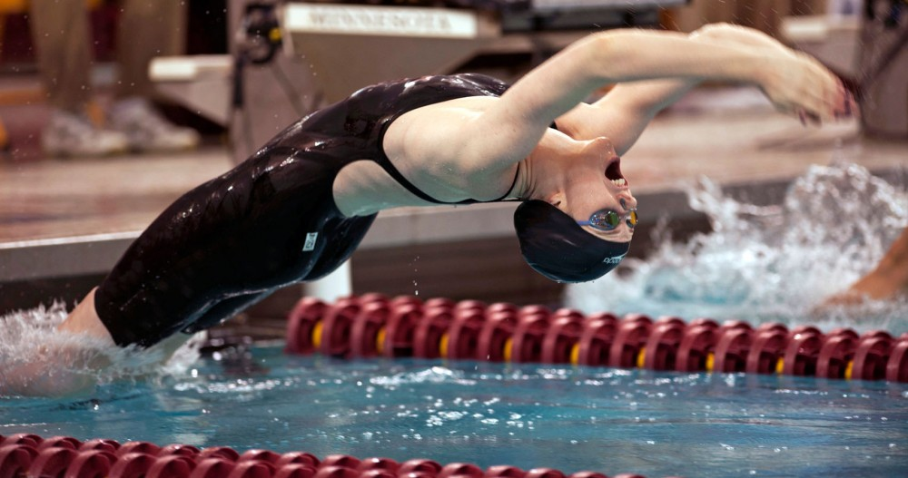 Four-time Olympic gold medalist Missy Franklin competes in a final round of 100-yard backstroke in USA Swimming's Minneapolis Grand Prix on Saturday at the University Aquatic Center.