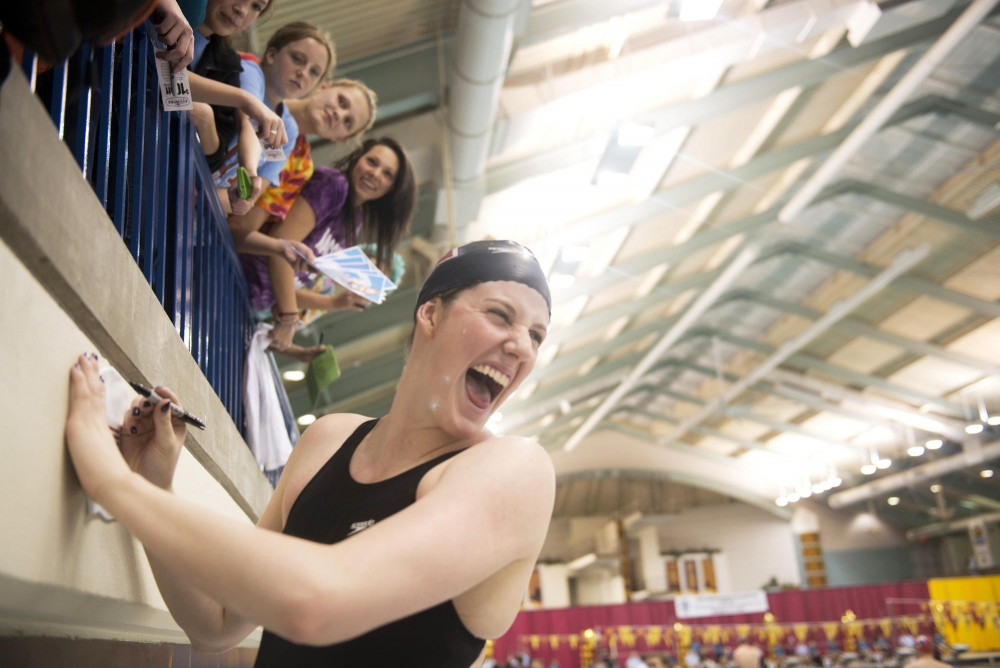 Olympian Melissa Franklin signs autographs after USA Swimming's Minneapolis Grand Prix on Sunday at the University Aquatic Center.