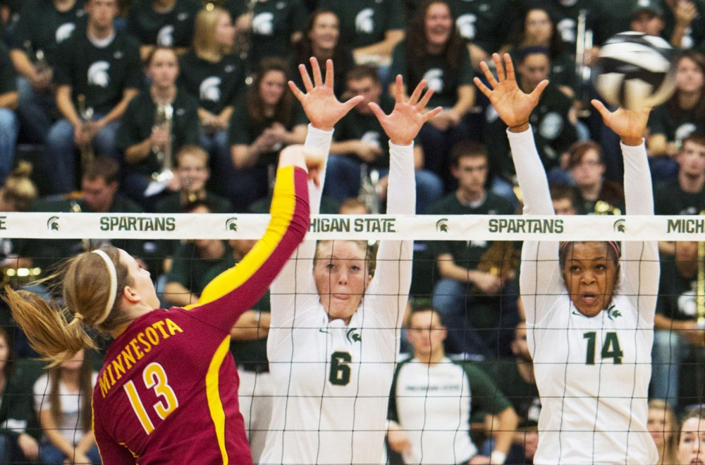 Minnesota outside hitter Ashley Wittman hits into the Michigan State block Friday in East Lansing, Mich. The Gophers lost 3-1.