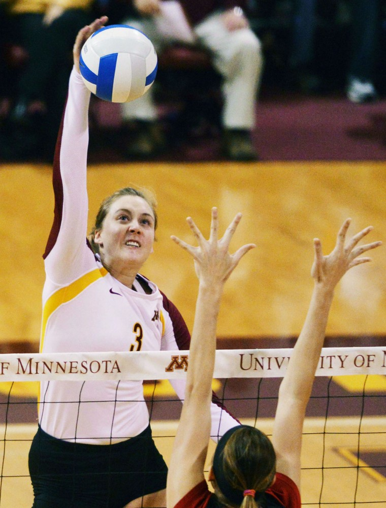 Middle blocker Dana Knudsen spikes the ball against Nebraska on Nov. 16 at the Sports Pavilion.