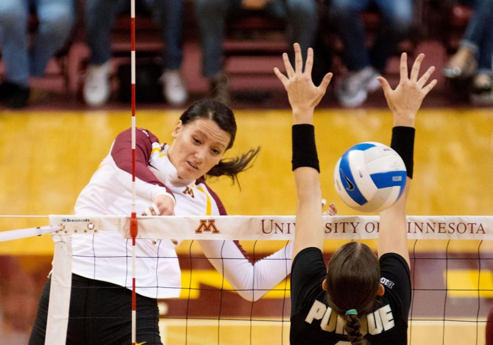 Minnesota middle blocker Tori Dixon spikes through Purdue's block during a match Oct. 20 at the Sports Pavilion.