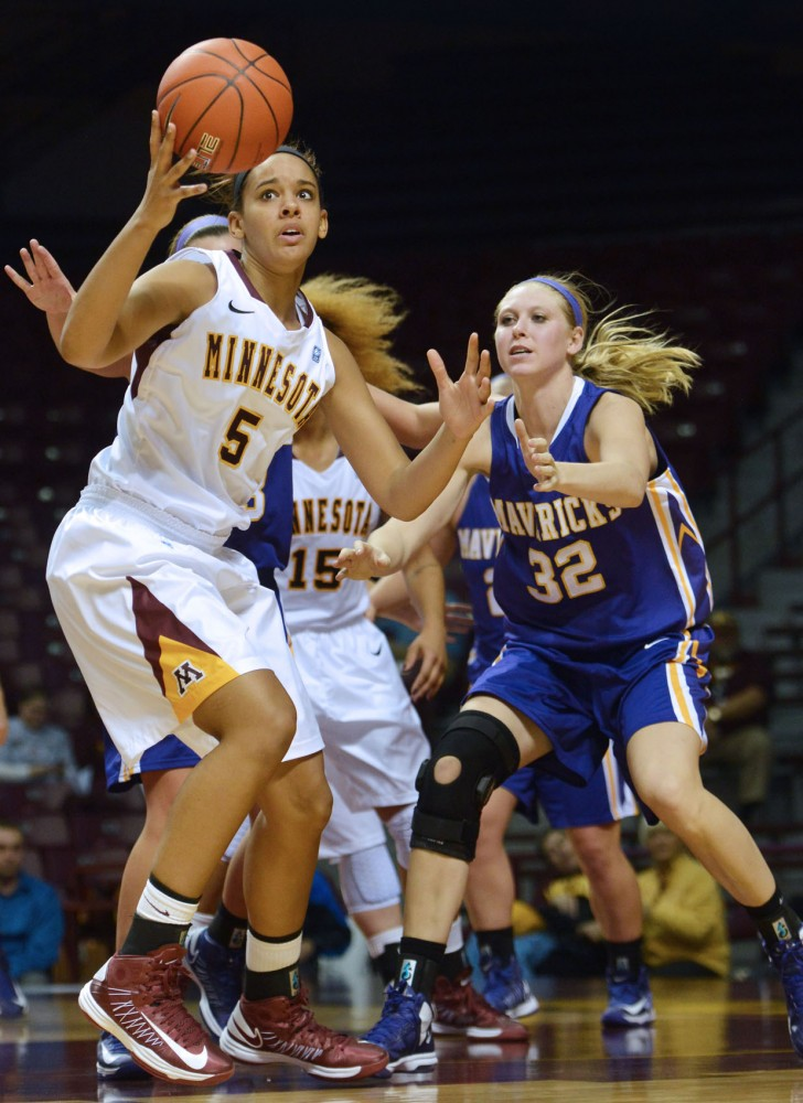 Minnesota forward Kionna Kellogg pulls away from Minnesota State's Kathleen Reynolds during Sunday's game at Williams Arena.The Gophers took a 66-56 win over the Mavericks.