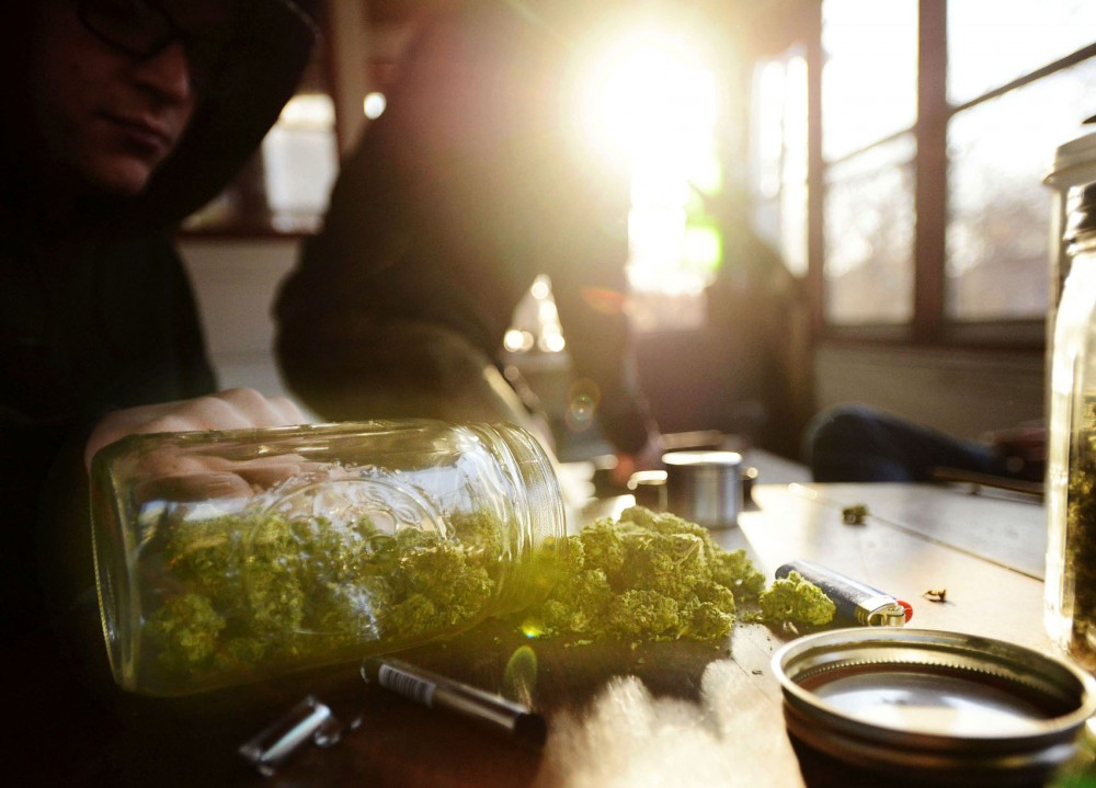 A jar of marijuana sits on a University student's table Monday afternoon. The Minnesota chapter of the National Organization for the Reform of Marijuana Laws is working to draft legislation to legalize marijuana.
