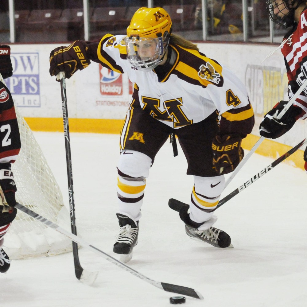 Minnesota forward Becky Kortum chases a puck during a game against St. Cloud State on Oct. 6, 2012 at Ridder Arena.