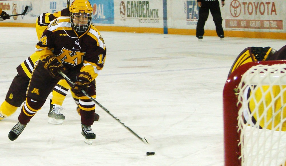 Minnesota forward Maryanne Menefee drives in for a goal Friday in Duluth, Minn. Menefee had two goals on the weekend as the Gophers swept Minnesota-Duluth.