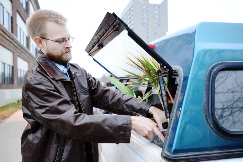 Princeton Review operations manager Law Schuelke packs a last few items from their old location into his car on Friday outside of the UTEC building in Dinkytown.