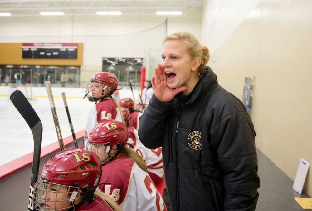 Natalie Darwitz coaches Lakeville South players during a game against Burnsville High School on Nov. 6 at Hasse Arena in Lakeville, Minn. Darwitz is in her second season as Lakeville South's head coach.