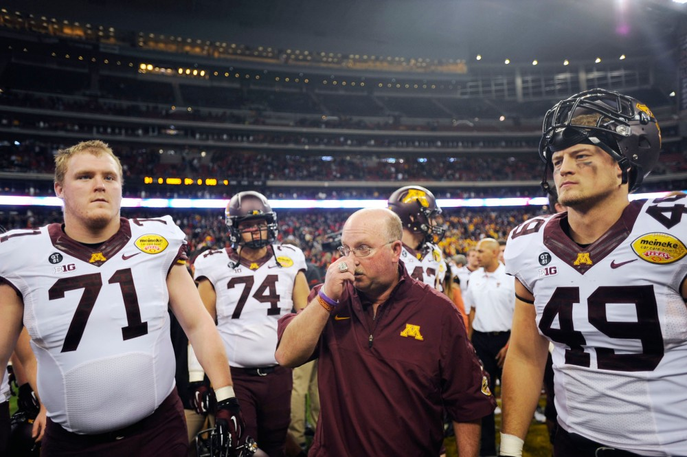 Minnesota head coach Jerry Kill walks out off the field at Reliant Stadium with players after losing the Meineke Car Care Bowl on Friday, Dec. 28, 2012, at Reliant Stadium in Houston, Texas.