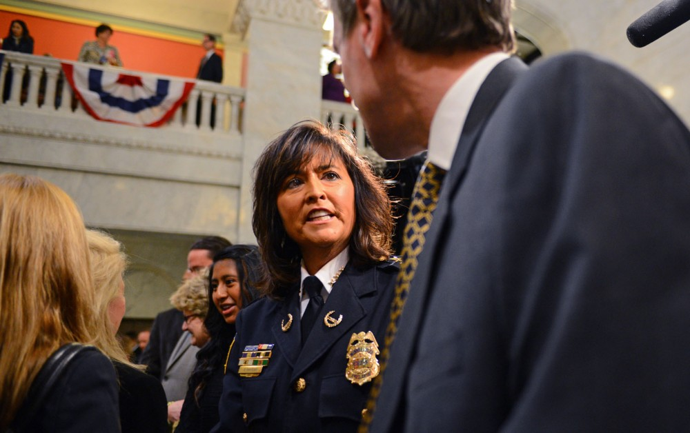 New police chief Janee Harteau, center, and Mayor R.T. Rybak, right, speak between congratulations from city council members, citizens and other officers Dec. 4 at Minneapolis City Hall.