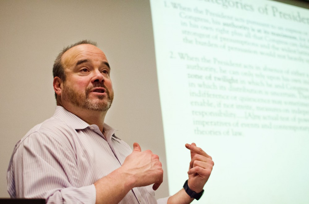 Larry Jacobs lectures in his Presidential Leadership and American Democracy class Thursday evening in Blegen Hall.