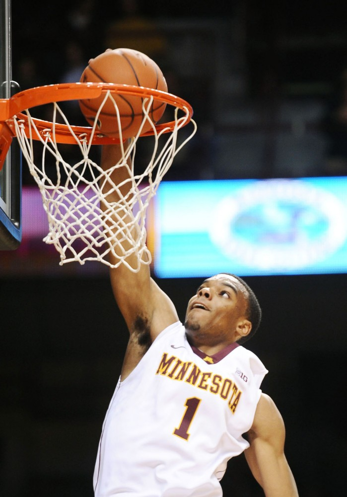 Minnesota guard Andre Hollins dunks during against Minnesota State-Mankato on Nov. 1 at Williams Arena.