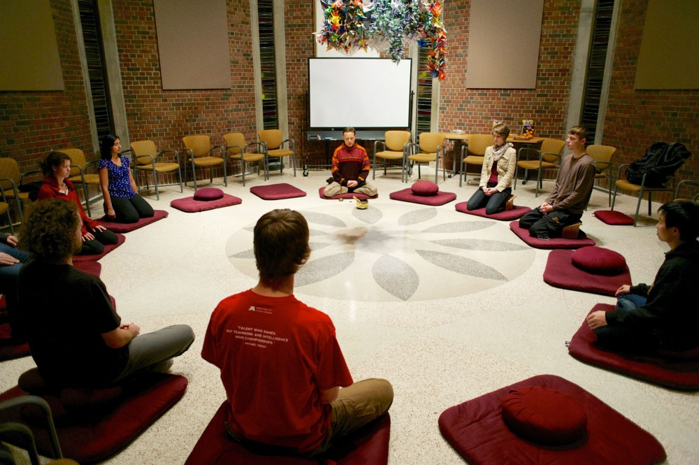 Mark Nunberg, center, a guiding teacher a Common Ground Meditation Center, leads the Mindfulness for Students club in a sit Friday at the Mayo Memorial Building. The group meets weekly for sessions of mediation and yoga.