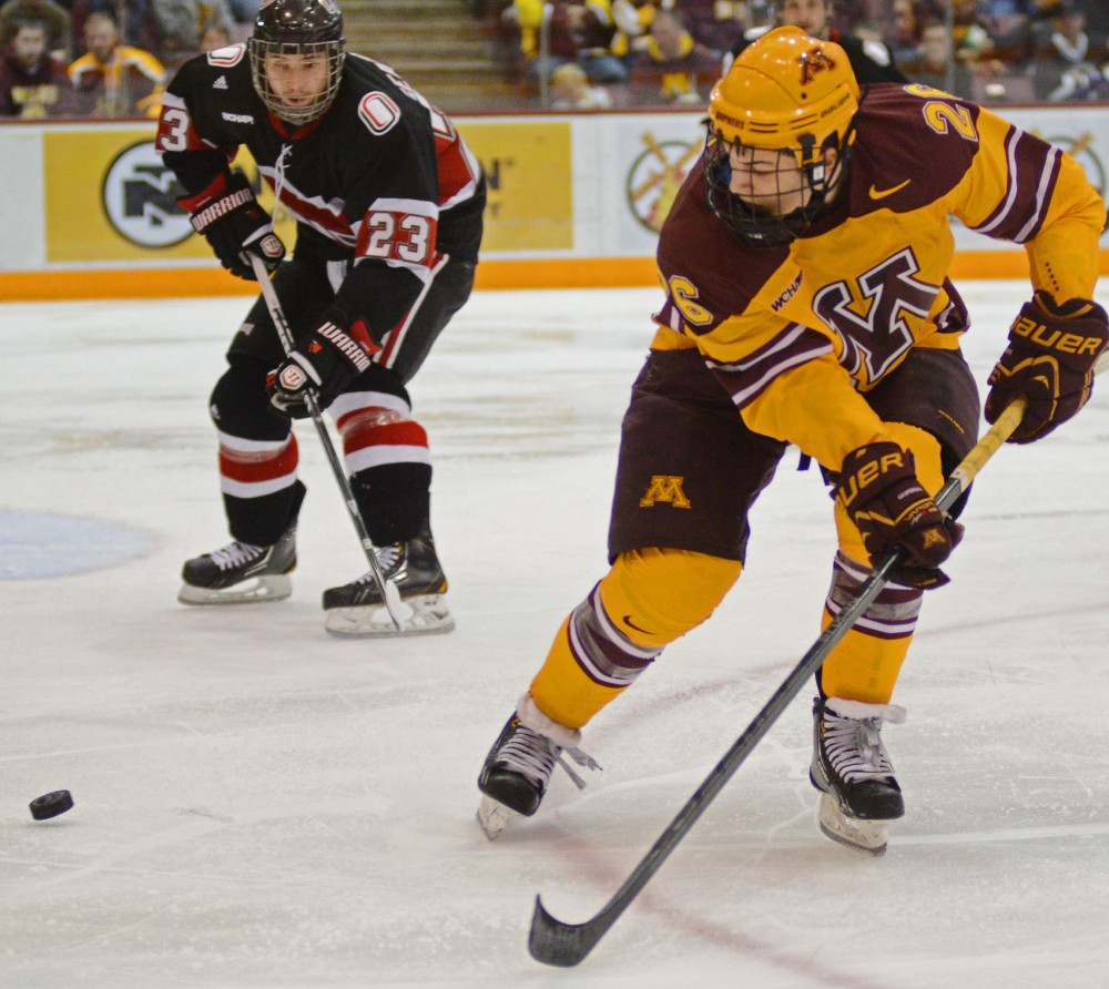 Minnesota forward Christian Isackson passes the puck against Omaha on Saturday night at Mariucci Arena.