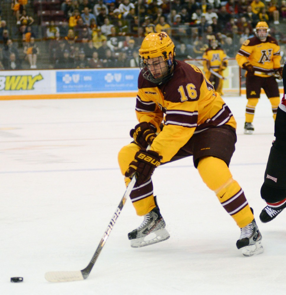 Minnesota forward Nate Condon steals the puck from Omaha on Saturday night versus Omaha at Mariucci Arena.