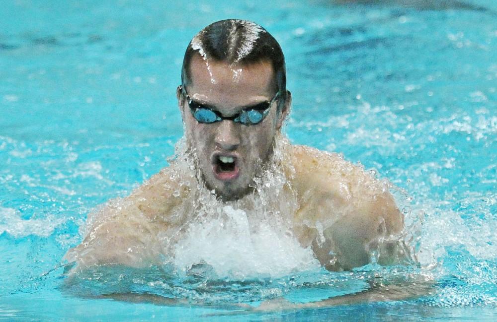 Kyler Van Swol swims the Men's 100 Yard Breaststroke on Saturday at the Aquatic Center.