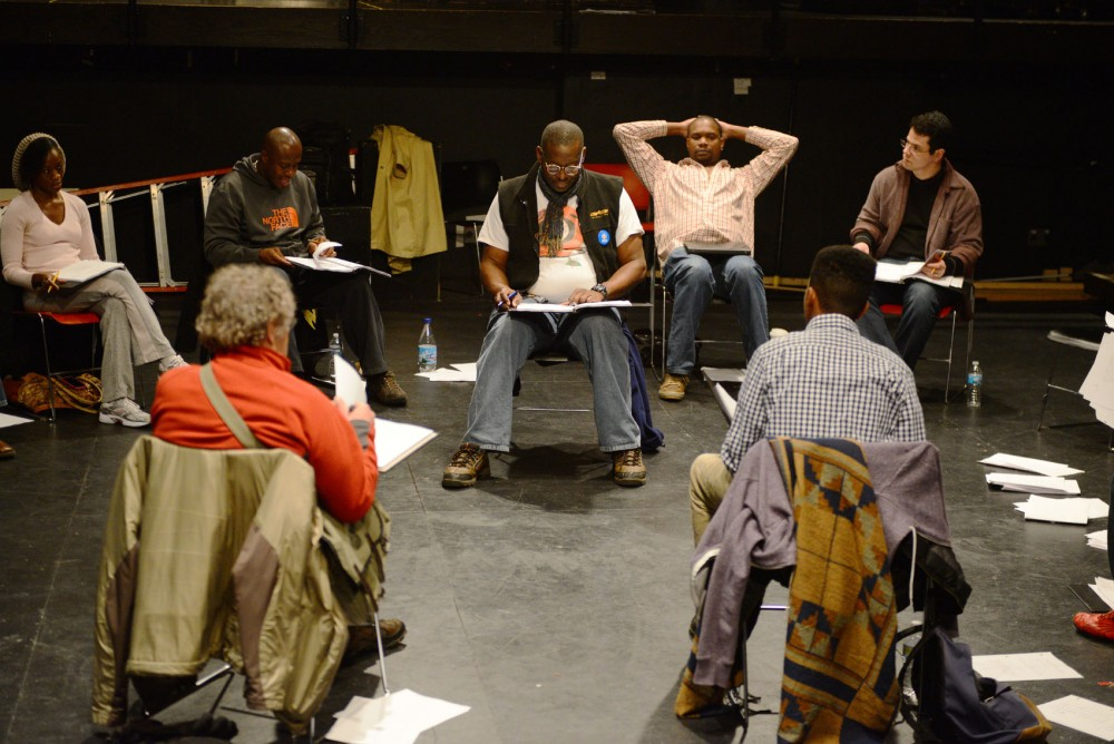 Bruce A. Young reads lines during a rehearsal for