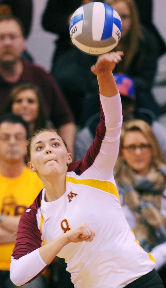 Minnesota outside hitter Katherine Harms serves against Creighton on Saturday, Dec. 1, 2012, at the Sports Pavilion.
