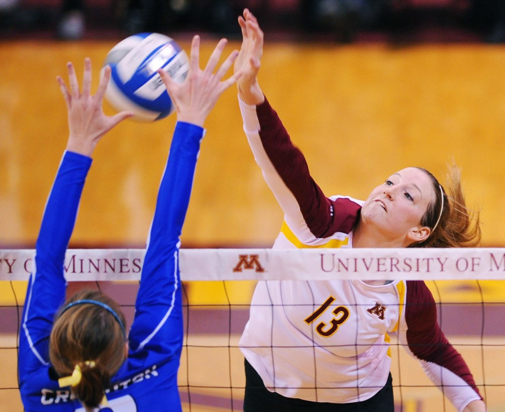 Minnesota outside hitter Ashley Wittman spikes through Creighton's block Dec. 1 at the Sports Pavilion.